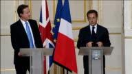 Cameron/Sarkozy joint press conference PARIS France PM and Nicolas Sarkozy into presser Nicolas Sarkozy press conference SOT I am delighted to be...