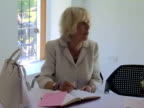 Camilla Duchess of Cornwall and Birgitte Duchess of Gloucester signing memorial book Duchess of Cornwall visits Life Skills Centre on June 05 2013 in...