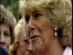Camilla ParkerBowles chats and smiles to wellwishers at garden party
