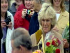 Camilla ParkerBowles clutches flowers surrounded by well wishers leaving church people take photos of her and Prince Charles Aug 02