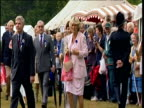 Camilla ParkerBowles wearing pink walks though crowds at garden party zoom in
