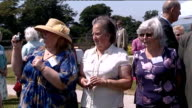 Camilla visit to Little Harbour Hospice in St Austell EXT **Music heard intermittently SOT** People next to tents / 'Children's hospice South West'...