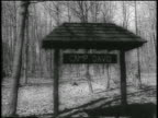 B/W 1959 'Camp David' sign in forest / presidential retreat in Maryland / newsreel