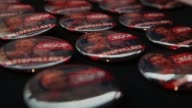 Campaign button feature the hashtag #STOPHILLARY are seen at the booth of Oklahoma Republicans during the conference Oklahoma City Oklahoma May 22...