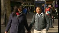 LGBT campaigner Aderonke Apata mounts legal bid to stop deportation to Nigeria T28031441 / TX Aderonke Apata and Happiness Agboro along street hand...