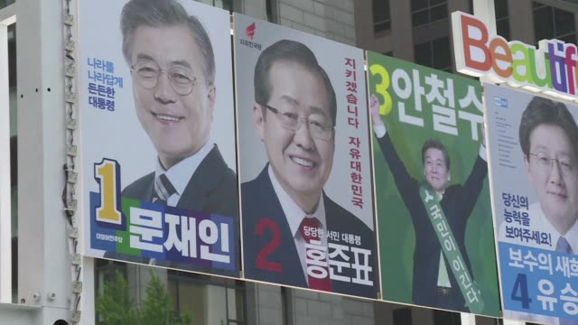 Campaigners for the South Korean presidential candidates make a final push for votes a day before the polls with the left leaning candidate Moon...