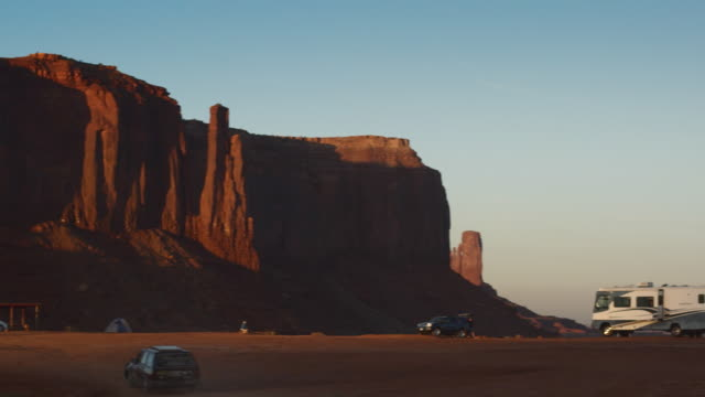 WS, PAN, Campground and East Mitten and West Mitten buttes at sunset, Monument Valley, Arizona, USA