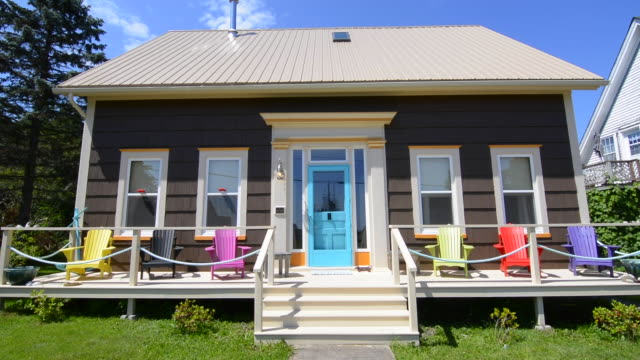 Canada St Martins New Brunswick colorful home in town called The Cronk House 1869 with colorful Adirondack chairs on porch