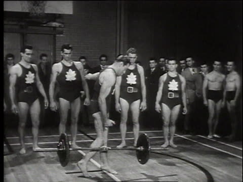 1949 MONTAGE Canadian bodybuilders lifting weights / Canada