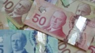 Canadian dollar banknotes are displayed in an arranged photograph in Toronto Canada on Monday May 30 2016 Shots shot of dollars sitting in pile...