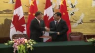 Canadian Prime Minister Stephen Harper said he had signed deals with China worth $22 billion on Saturday in a trip overshadowed by Beijing's...