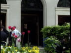 Canary Wharf's future EXT LA CMS Sign to Mansion House St MaryleBow Bank of England TILT DOWN branch of Lloyds Bank MS Bank branch with flowers in...