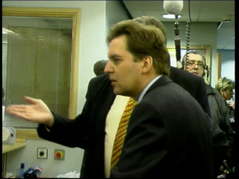 PHILIP ENGLAND Newcastle Newcastle General Hospital Alan Milburn MP along thru reception as arriving for hospital visit MS Monitors on desk PAN to...