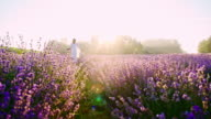 SLO MO Candid shot of a woman walking among lavenders