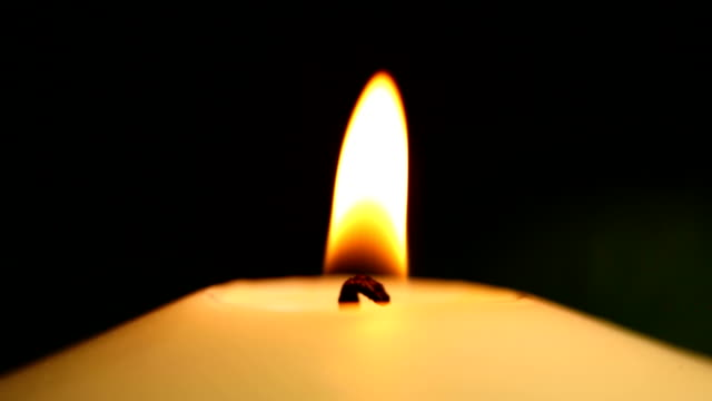 candle in the dark - close up
