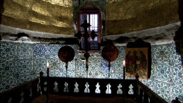 Candles burn on the altar of the Chapel of the Burning Bush in Saint Catherine's Monastery. Available in HD.