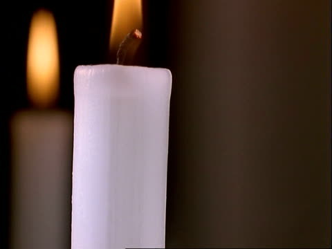T/L BCU candles burning down, black background, flame