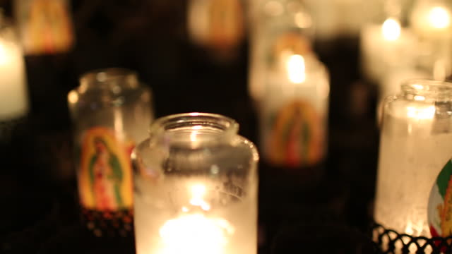 Candles burning inside of a church.