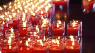 Candles in red transparent chandeliers