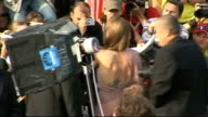 'Inglourious Basterds' premiere Brad Pitt and Angelina Jolie along on red carpet / Back views Pitt and Jolie signing autographs / Quentin Tarantino...