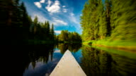 TIME LAPSE: Canoe bow on a river