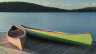 MS Canoes on cottage dock in Smoke Lake at Algonquin Park / Whitney, Ontario, Canada