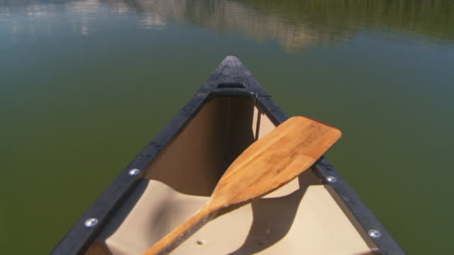 canoing on mountain lake