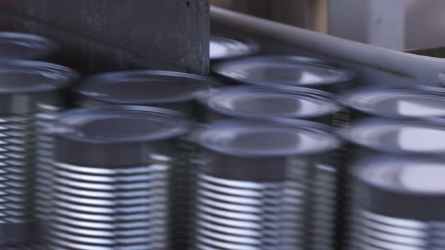 Cans At Fork In Production Line