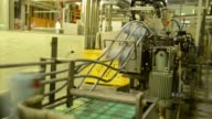 Cans of Yo Ho Brewing Co Suiyobi No Neko beer move along a conveyor on the production line at the company's brewery in Saku Nagano Prefecture Japan...