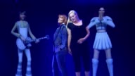 Cantar en un escenario con una version virtual de los miembros de ABBA VOICED Fiebre de ABBA en un nuevo museo on May 07 2013 in Stockholm Sweden