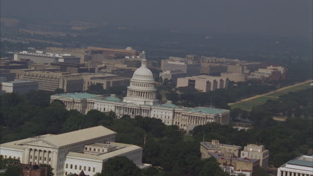 LOW AERIAL Capitol Building and Washington Monument, Washington DC, Washington, USA