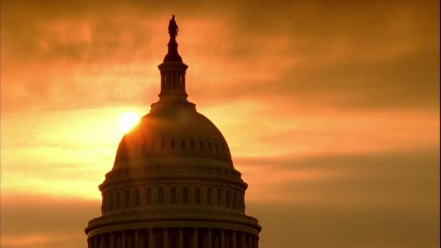 WS Capitol Building dome Statue of Freedom top w/ sun BG burnt orange spreading yellow sky