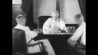 Capitol building Governor Junius Marion Futrell sitting at desk denying 'any pillage in Arkansas challenges outside agitators to prove'