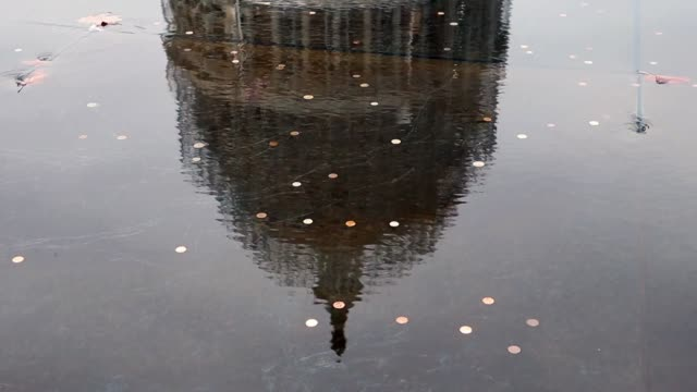Capitol reflected in fountain full of coins on Capitol plaza on November 04 2014 in Washington DC