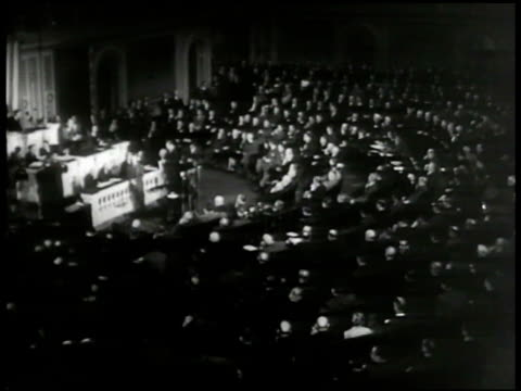 S Capitol steps Washington DC INT VS Congress in session MS Speaker of House Sam Rayburn hammering at podium CU Newspaper '2 1/2 Year Draft Wins by 1...