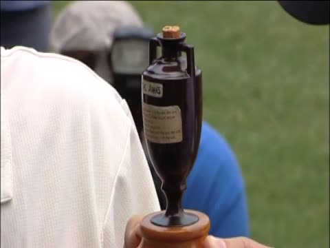 Captain of the England cricket team Andrew Strauss and the Captain of the Australia cricket team Ricky Ponting hold a replica of the Ashes urn
