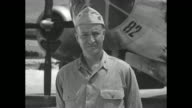Captain William Sterling Parsons of the US Navy stands on airfield in front of the Enola Gay he served as weaponeer and mission commander during the...