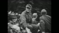 [Captured German footage VO music and French language throughout] German officers with small rifles around their necks / VS German soldiers and...