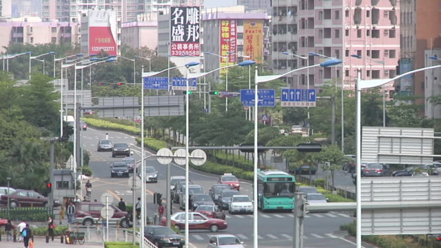 MS Car and pedestrian traffic at street / Shenzen, Guangdong,  China