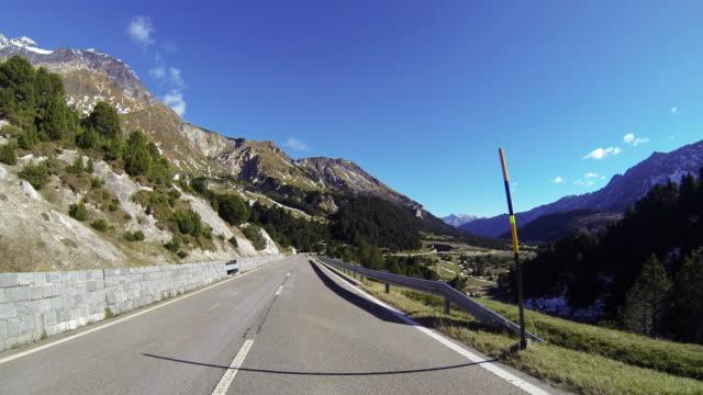 Car ascending mountain pass POV