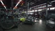 WS Car body parts and welding equipment in welding area of auto factory / Samut Prakan, Bang Muang Mai, Thailand