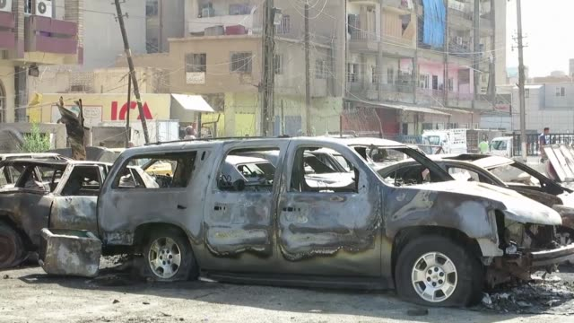 A car bomb exploded near a liquor store in central Baghdad Tuesday killing at least two people security and medical sources said