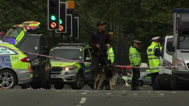 GVs of scene ENGLAND London Kensington EXT Various of armed police and emergency services in road at scene of crash 'museums' sign police putting up...