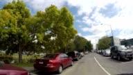 Car drives along Christchurch road, New Zealand