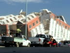 Car drives past destroyed houses following devastating earthquake in Chile 4 February 2010