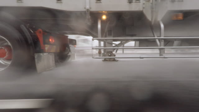 Car driving at rainy day - side view -4K