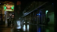 TS A car driving down a city street at night / New Orleans, Louisiana, United States