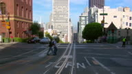 WS car POV driving down steep and busy street/ San Fransciso, California