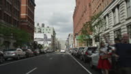 Car POV driving in NYC and then stopping at red light