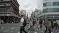 Car POV driving in NYC then stopping at light for pedestrian crossing